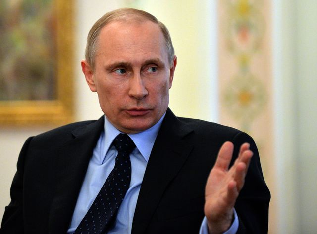 Is Vladimir Putin in another world? Or a realist? Photographer: Yuri Kadobnov/AFP/Getty Images