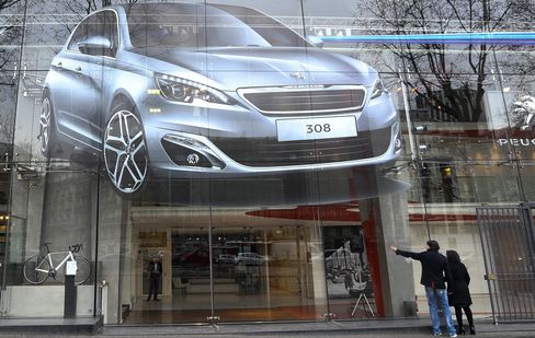 A Peugeot 308 Poster sits Outside a Car Showroom in Paris