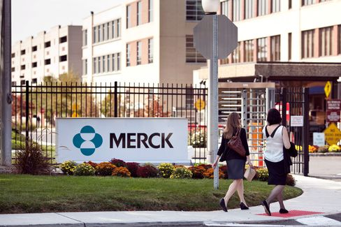 Pedestrians Walk Outside a Merck & Co. Facility