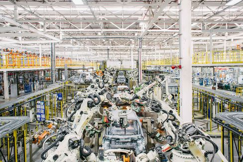 Prosperity in Thailand is spreading from glitzy Bangkok to less-developed regions, thanks in part to a boom in auto-manufacturing in places such as Rayong province, where this state-of-the-art Ford plant is located. Photographer: Ian Teh/Bloomberg Markets