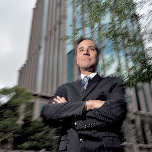 Alexandre Caiado, a former private banker for Merrill Lynch & Co., poses in front of the Merrill Lynch office in Sao Paulo, Brazil, on Sept. 8, 2010. Photographer: Paulo Fridman/Bloomberg Markets via Bloomberg