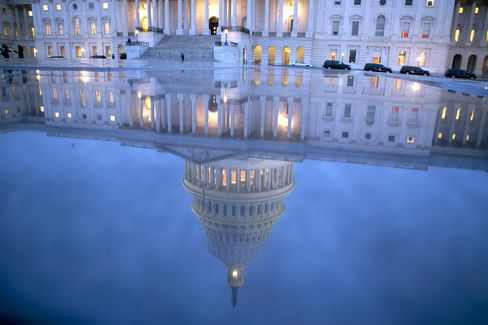 The U.S. Capitol is reflected in Washington. Photographer: Andrew Harrer/Bloomberg