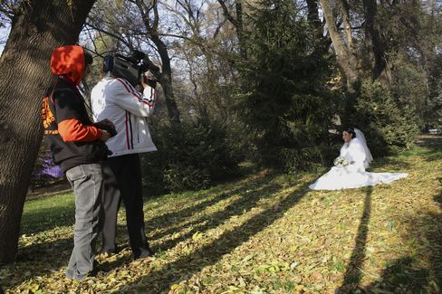 A Bride is Filmed in Panfilov Park in Almaty