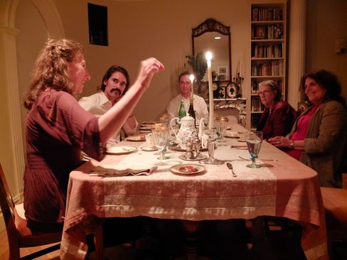 Steffen Landauer, center, former Citigroup Inc. executive , and his wife Helga Landauer, left, host a death dinner at their home in New York with friends Peter Rhoads, second left, Pamela Kraft, second right, and Laura Simms. Photographer: Shannon Pettypiece /Bloomberg