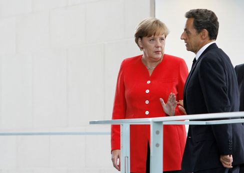 Germany's Angela Merkel with France's Nicolas Sarkozy