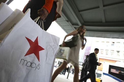 A shopper holds Macy's bags, NY