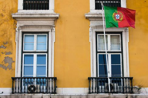 The Portuguese National Flag Flies Outside a Building in Lisbon