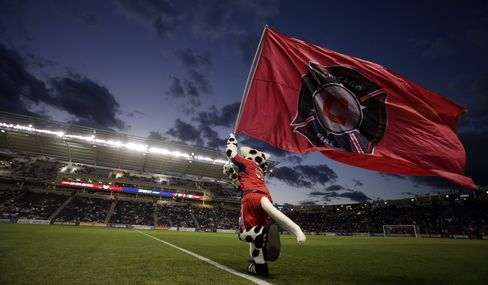 The Chicago Fire mascot runs on to the field at Toyota Park on September 8, 2012 in Bridgeview, Illinois. Photographer: Tasos Katopodis/Getty Images
