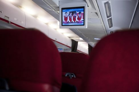 A security demonstration video on an in-flight screen.