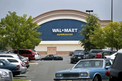 Wal-Mart Rising, IOUs Falling Show Weak Economy