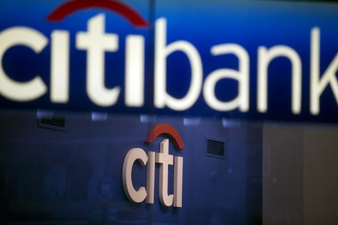 Signage is displayed inside a Citigroup Inc. Citibank branch in New York. Photographer: Victor J. Blue/Bloomberg