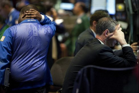 Traders work on the floor of the New York Stock Exchange. Photographer: Scott Eells/Bloomberg