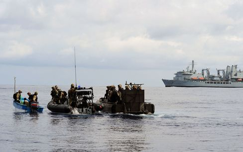 A Royal Navy team boarding a pirate skiff on the Somali coast. Photographer: Rex Features via AP Images