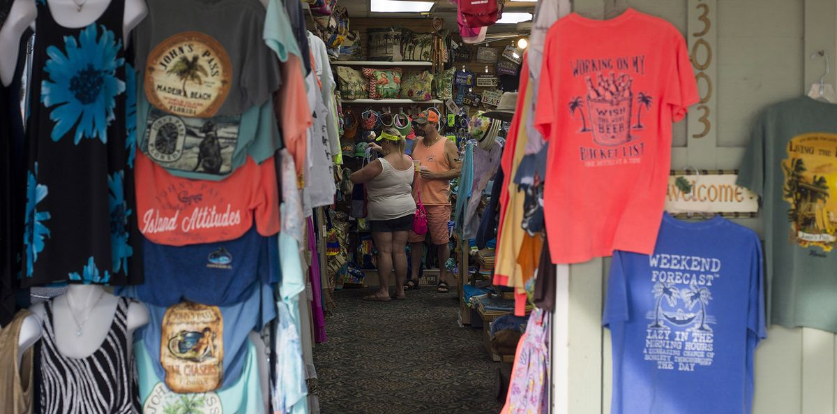 Shoppers look at clothing inside of a store in Madeira Beach, Florida.