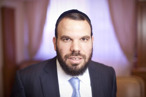 Billionaire Dan Gertler poses for a photograph in his office at the Israel Diamond Exchange in Ramat Gan, Israel, on Tuesday, June 12, 2012.  Photographer: Simon Dawson/Bloomberg