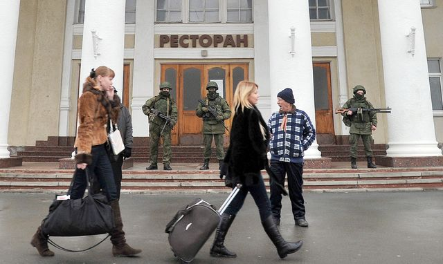 Who are those guys in camo? Photographer: Genya Savilov/AFP/Getty Images