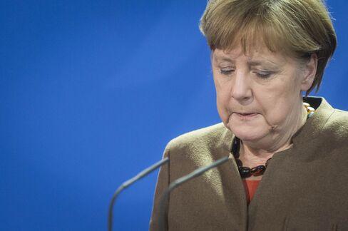 Angela Merkel speaks to the media following the atatcks in Brussels