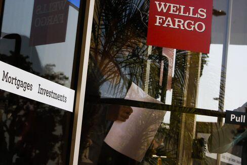 A Customer Exits a Wells Fargo & Co. Branch in Hermosa Beach