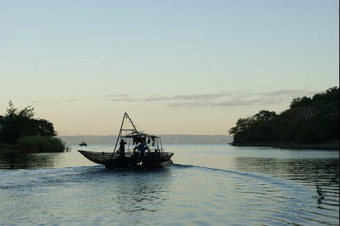 A Fishing Boat Sails on Lake Kariba