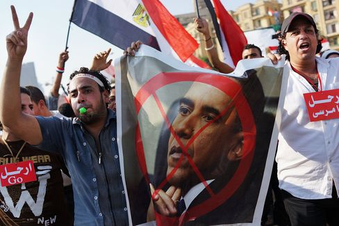 Mursi's Ouster Leaves U.S. Dilemma on Law Barring Aid After Coup