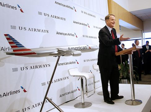 Doug Parker, chief executive officer of US Airways Group Inc., during a press conference at Dallas Fort Worth Airport in Texas, on Feb. 14, 2013. Photographer: Mike Fuentes/Bloomberg