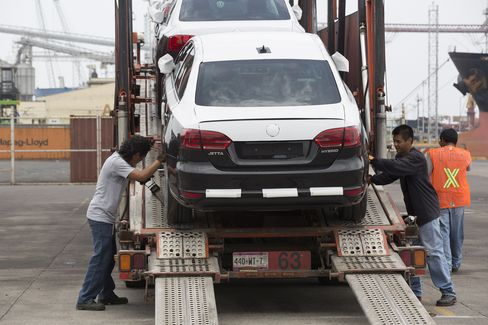 An Automobile is Loaded onto a Car Carrier at Veracruz Port