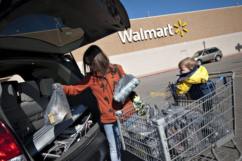 Wal-Mart Cuts Profit Forecast as Higher Taxes Damp Traffic