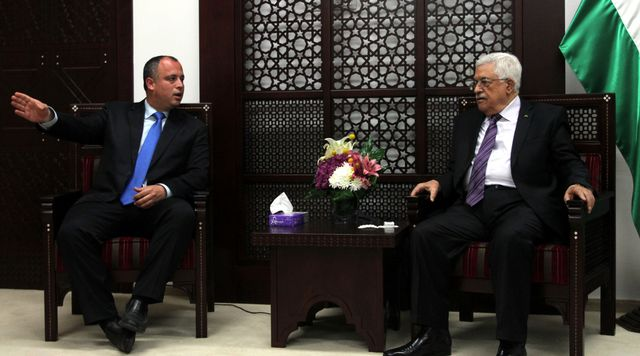 Palestinian President Mahmoud Abbas meets with Hilik Bar, a member of the Israeli Knesset, on April 16 in Ramallah.Photographer: Issam Rimawi/Anadolu Agency/Getty Images