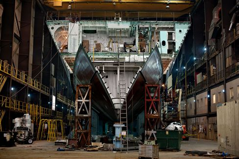 A large section of a U.S. Navy Littoral Combat Ship (LCS) sits in the final assembly area during its construction at Marinette Marine Corp., in Marinette, Wisconsin.  Photographer: Daniel Acker/Bloomberg