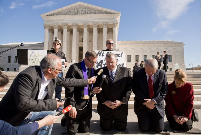 On reflection, I was overly optimistic. Religious activists pray following oral arguments in Town of Greece v. Galloway on Nov. 6, 2013. Photographer: Saul Loeb/AFP/Getty Images