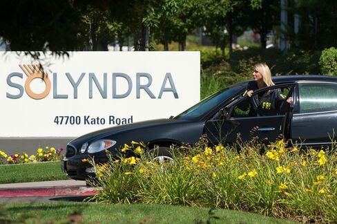 An FBI agent enters the Solyndra LLC headquarters in Fremont, California on Sept. 8, 2011. Photographer: David Paul Morris/Bloomberg
