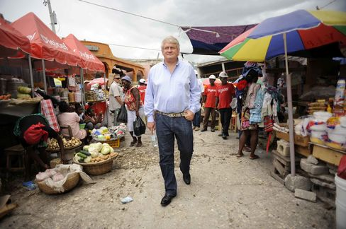 In the wake of a 2010 earthquake, O'Brien, Ireland's richest native son, visits a Port-au-Prince street market in Haiti, the biggest single market for his Digicel Group Ltd. Photographer: Antonio Bolfo/Getty Images