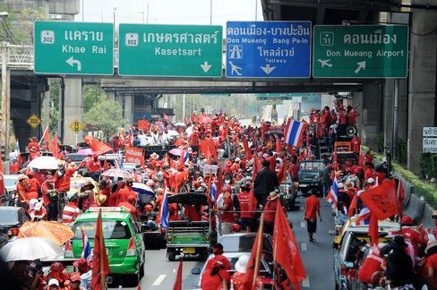 Red-Shirted demonstrators leave a rally site