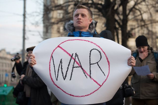 A demonstrator holds an anti-war sign during a pro-Ukraine rally March 7 in Moscow. Photographer: Dmitry Serebryakov/AFP/Getty Images