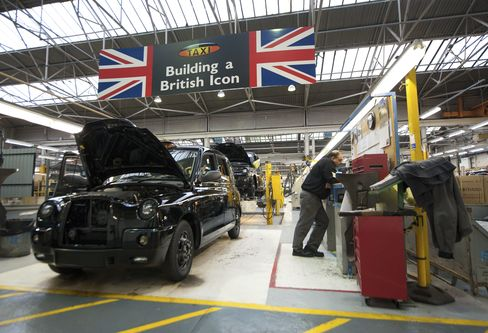 Production line workers assemble LTI taxis