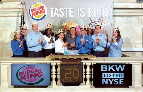 Schwartz (second from right) and co-workers celebrate Burger King's return to the stock market in 2012.