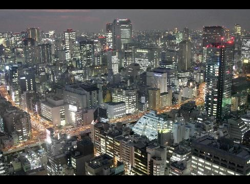 Buildings are illuminated after dusk in central Tokyo