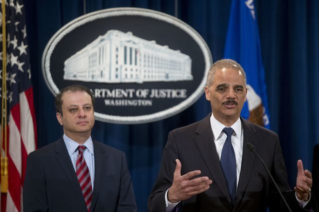 Preet Bharara and Eric Holder keep saying, and saying, too-big-to-jail doesn't exist. Photographer: Andrew Harrer/Bloomberg