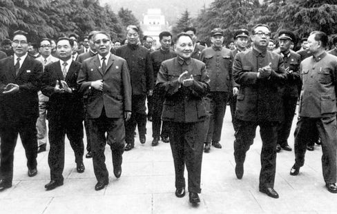 Deng Xiaoping, China's former leader, center, during a visit to Nanjing, Jiangsu Province, China, in 1985. Source: EyePress