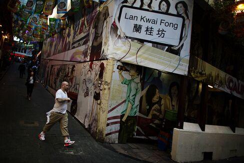 A Pedestrian In Lan Kwai Fong