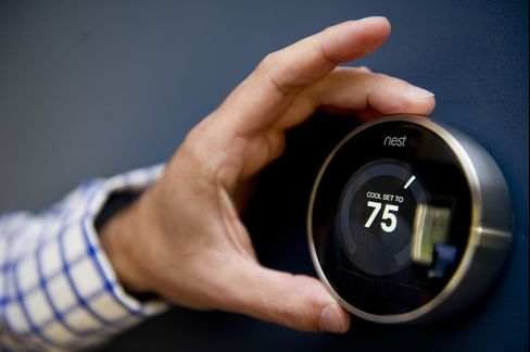 A Nest Labs Thermostat is Adjusted in a Home in West Newbury