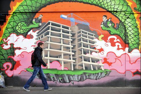 A Pedestrian Passes Graffiti in Dublin