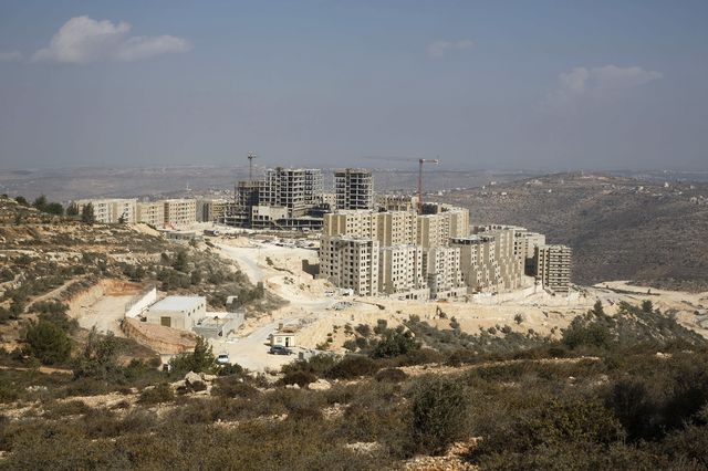 Just north of Ramallah, the planned Palestinian city of Rawabi is emerging from the side of a hill. Photographer:  Ilia Yefimovich/Getty Images