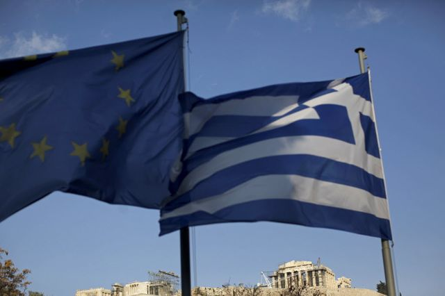 Waving a flag for Greek yields.                                                 Photographer: Kostas Tsironis / Bloomberg