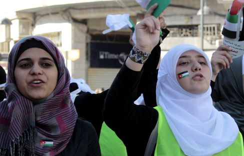 Jordan Rally Calls for Democracy; Syrians Protest Amid Fighting