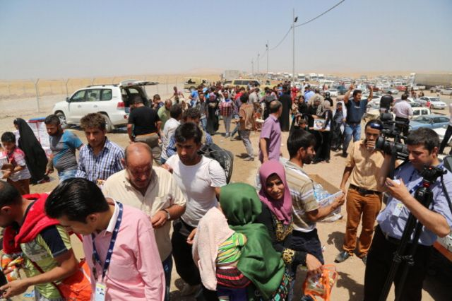 Thousands fled Mosul, Iraq, after Sunni extremists took control of the city.