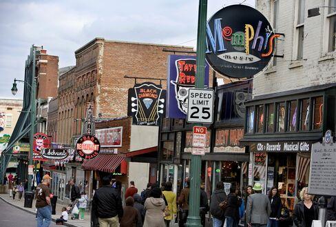 Pedestrians Walk Down a Street in Memphis