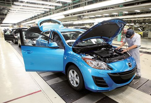 The Mazda Motor Corp.'s 3 model is seen on the production line of the company's Hofu plant in Hiroshima. The model became Australia's top seller in 2011, breaking a 15-year run for Holden's Commodore. Source: Mazda Motor Co. via Bloomberg