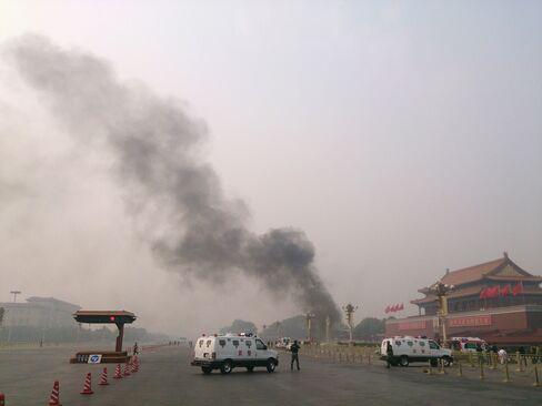 Smoke Rises Following a Vehicle Crash in Beijing Last Year