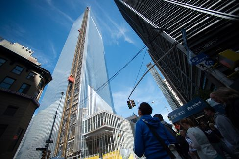 Pedestrians look up at the 4 World Trade Center building in New York. Photographer: Craig Warga/Bloomberg